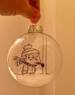 vinyl design from the movie a Christmas Story, fake snow in the bottom of the ornament